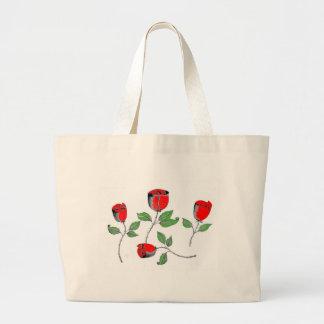 La bolsa de asas con los rosas