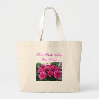 La bolsa de asas con los rosas rosados