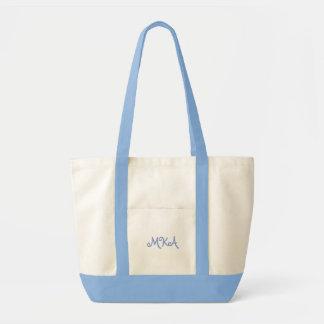 La bolsa de asas con monograma de los azules claro