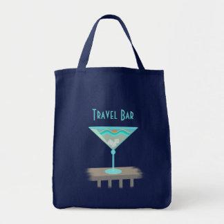La bolsa de asas de la bebida de la playa