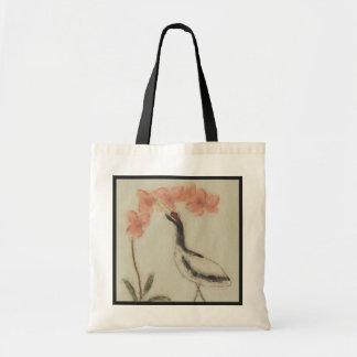 La bolsa de asas de la grúa y de la orquídea