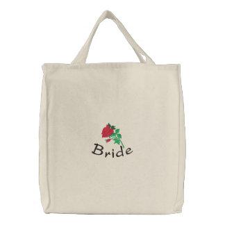 La bolsa de asas de la novia bordada con el rosa r