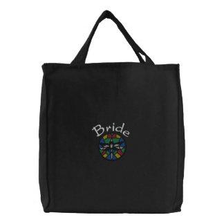 La bolsa de asas de la novia bordada con la libélu