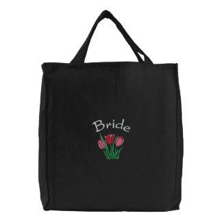 La bolsa de asas de la novia bordada con los tulip