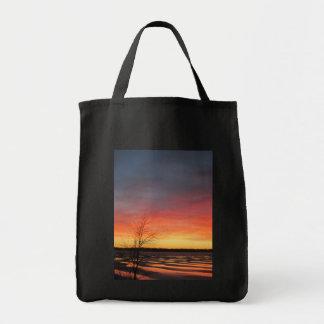 La bolsa de asas de la puesta del sol del lago ice