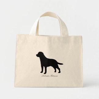La bolsa de asas de la silueta del negro del perro