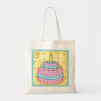 La bolsa de asas de la torta del feliz cumpleaños
