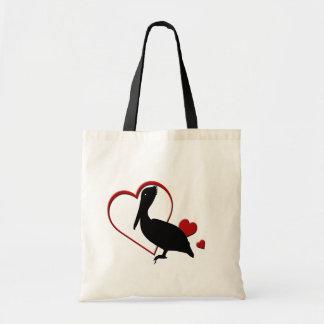 La bolsa de asas de los corazones del pelícano del