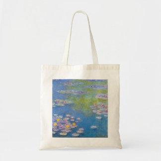 La bolsa de asas de los lirios de agua amarilla de