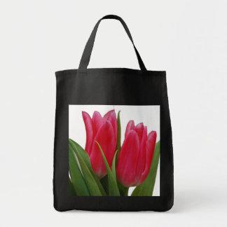 La bolsa de asas de los tulipanes de las rosas fue
