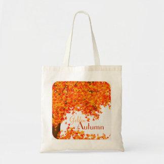 La bolsa de asas de oro del otoño - árbol y hojas