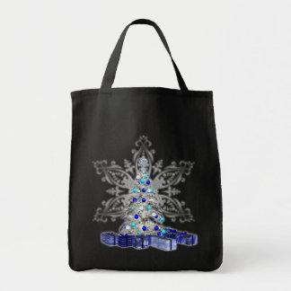 La bolsa de asas del árbol de navidad del copo de