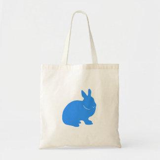 La bolsa de asas del conejo de conejito silueta a