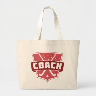 La bolsa de asas del escudo del coche de hockey
