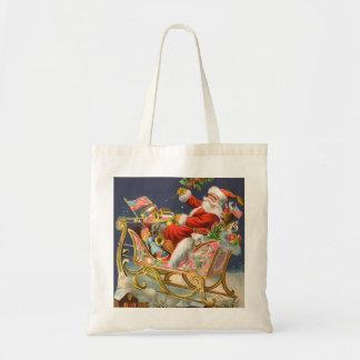 La bolsa de asas del papel de regalo del navidad d