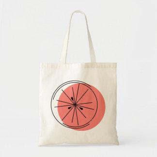 La bolsa de asas del pomelo rosado