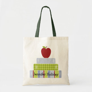 La bolsa de asas del profesor apilado de los libro