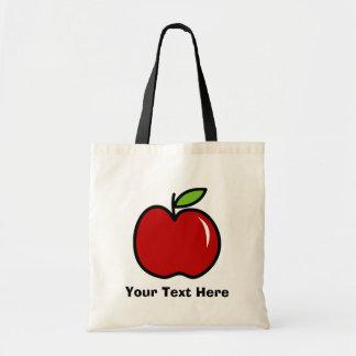 La bolsa de asas del profesor con la manzana roja