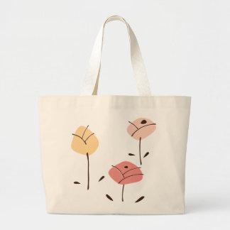 La bolsa de asas en colores pastel de los rosas