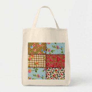 La bolsa de asas floral del remiendo de la tela