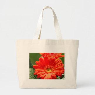 La bolsa de asas grande de la margarita anaranjada