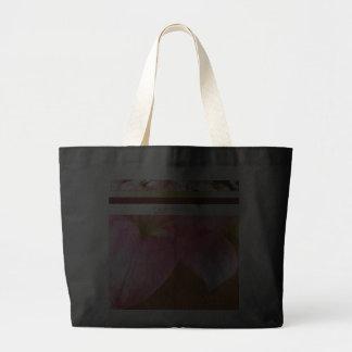 La bolsa de asas grande rosada del lirio de día po