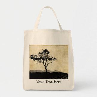 La bolsa de asas linda de la silueta del árbol
