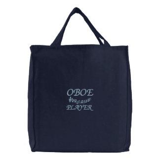 La bolsa de asas linda del jugador de Oboe