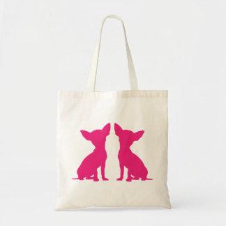 La bolsa de asas linda del perro rosado de la