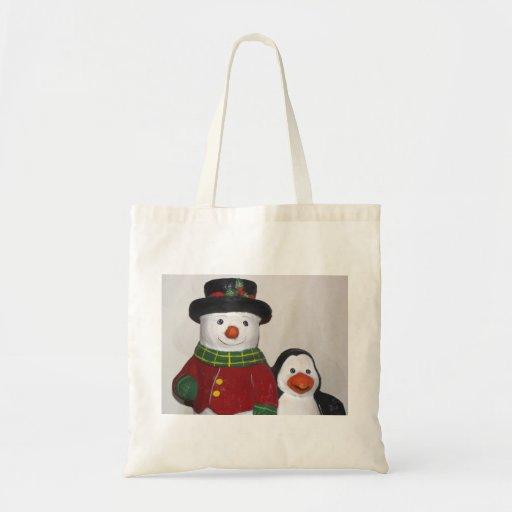 La bolsa de asas muy linda del muñeco de nieve y d