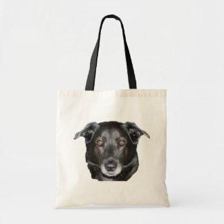 La bolsa de asas negra de la foto del perro de la