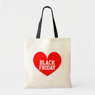 La bolsa de asas negra de las compras de viernes d