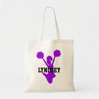 La bolsa de asas púrpura de la animadora