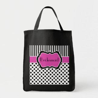 La bolsa de asas rayada rosada, negra, blanca de l