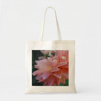 La bolsa de asas rosada de la flor