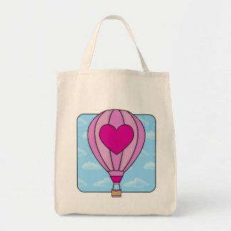 La bolsa de asas rosada del globo del aire calient