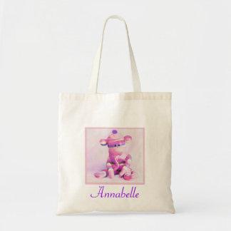 la bolsa de asas rosada del mono del calcetín