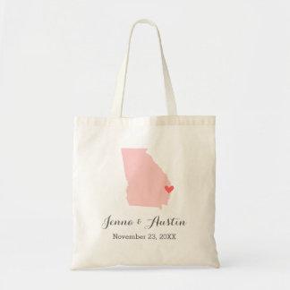 La bolsa de asas rosada y gris de la recepción del