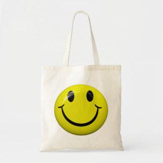 La bolsa de asas sonriente de la cara