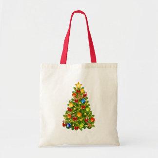 La bolsa de asas verde del árbol de navidad