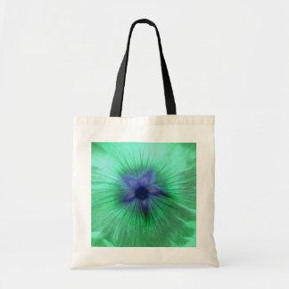 La bolsa de asas verde del presupuesto de la flor