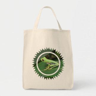 La bolsa de asas verde del ultramarinos de la rana