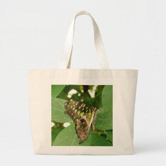 La bolsa de asas verde iridiscente tropical de la