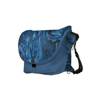 La bolsa de mensajero abstracta veteada azul del m bolsas de mensajería
