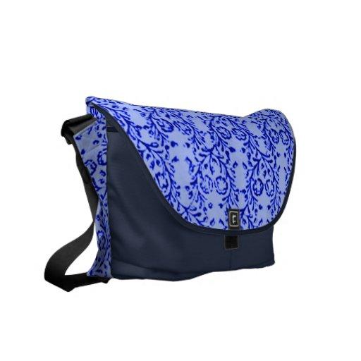 La bolsa de mensajero azul de medianoche floral de bolsa de mensajeria