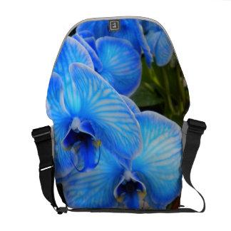 La bolsa de mensajero azul del carrito de las orqu bolsa messenger