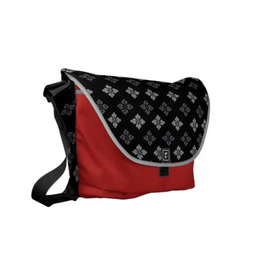 La bolsa de mensajero negra y roja de la flor del  bolsas de mensajería
