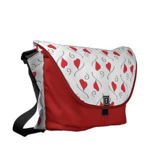 La bolsa de mensajero roja del carrito de los cora bolsa de mensajería