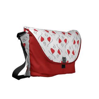 La bolsa de mensajero roja del carrito de los cora bolsa de mensajeria