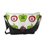 La bolsa de mensajero roja y verde de las manzanas bolsa de mensajeria